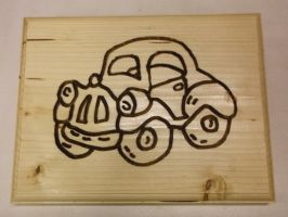 Michael Sibanda - A Christmas present for his son, Pajero, who is crazy about cars.  Free-hand routing using a 90 degree V-bit. Inspired by Beula Pypers - see two slides on. (added 20161205)